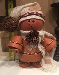 terra cotta ginger bread man with burlap and raffia 4