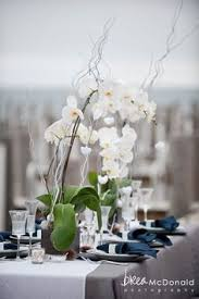 orchid centerpiece simple orchid centerpiece add small black and white framed