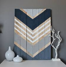 reclaimed wood wall large navy shades of gray and white adorn this reclaimed wood
