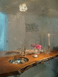 custom tile backdrop and wooden counter in the powder room design
