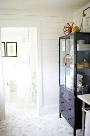 glass door linen cabinet cottage bathroom h2 design and build
