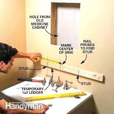 install cabinets like a pro the family handyman how to install a medicine cabinet install bathroom medicine cabinet