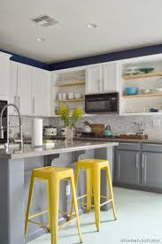 love the white top and grey bottom cabinets i like the pop of