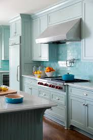 marble countertops blue kitchen backsplash tile mirorred glass
