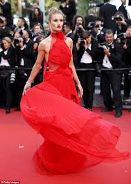 rosie huntington whiteley shows off figure in fiery red dress at