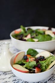 delicious leafy green fruit salad with savory dijon wine