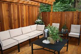 small deck in backyard with comfy seating idea and privacy fence