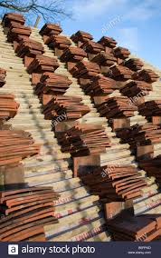 Barn Roof by Clay Roof Tiles Stacked On A Barn Roof Ready To Be Laid On The New
