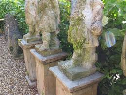 pair of boy garden statues with shields and swords