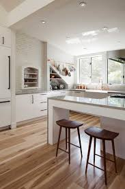 white kitchen cabinets wood floors how wood flooring warms up a white kitchen
