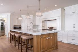 glass pendant lighting for kitchen islands rectangle brown wooden kitchen island with three white glass