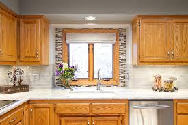 kitchen cabinets and backsplash oak kitchen cabinets kitchen eclectic with backsplash delta faucet