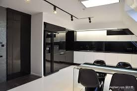 stunning modern black and white kitchen with black track lighting