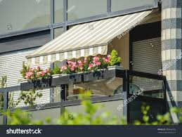 balcony awning opened beautiful flowers covered stock photo