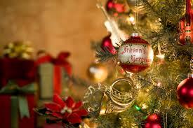 season s greetings ornament on tree kodiak electric association