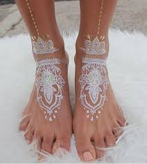 stunning white henna like tattoos look like lace draped over skin