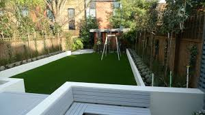 witching courtyard landscaping ideas with clear glass rectangle