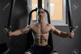 butterfly exercise machine bodybuilder doing heavy weight
