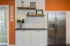 white kitchen cabinets orange walls orange kitchen walls surrounding white subway tile