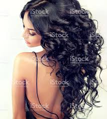 beautiful model with long black curled hair stock photo