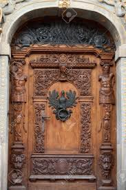 an wooden door with ornaments and sculptures in city