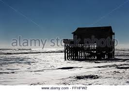 Beach House On Stilts Surrounded By High Tide Surf Nags Head