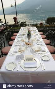 outdoor table set for dinner at hotel in bellagio italy on lake