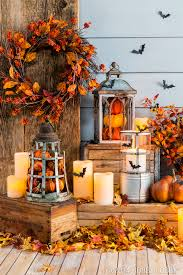 fill lanterns with pumpkins and other fall pieces for an easy diy