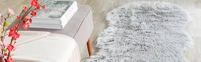 Imitation Sheepskin Rugs Amazon Com Safavieh Faux Silky Sheepskin Fss235a Ivory Area Shag