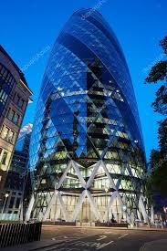 london glass building 30 st mary axe glass building or gherkin illuminated at night in