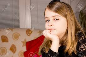 hair i woman s chin sideways pretty pensive little girl resting her chin on her hand and