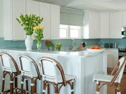 white kitchen cabinets with aqua backsplash white coastal kitchen features aqua tile backsplash hgtv