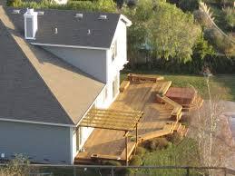 small backyard deck with garden and water fountain design idea