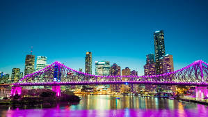 vibrant dolly time panorama of brisbane city with purple