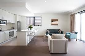large open floor plans grey hang lamp on the white ceiling of modern open floor plan