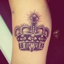 tattoo of a crown by andré de camargo