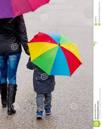 mother and child with umbrella download from over 55 million