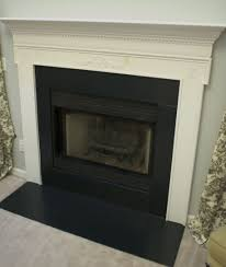 stacked stone tile fireplace surround top find this pin and more