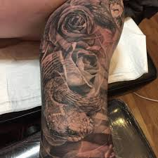 snake forearm tattoos black and white two snakes tattoo on right forearm