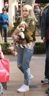 alice eve carries her pet dog as she does last minute christmas