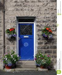 house blue front door with flowers royalty free stock photo