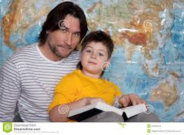 A Map Of The World Book by Dad And Son Reading Book On A Map Of The World Stock Images