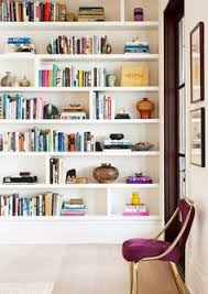 Gold Bookshelves by Decorating Shelves 1 Creating Balance By Using Weird Stuff