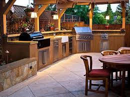 modern outdoor kitchen island constructed with integrated grill