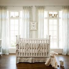 neutral baby nursery interior design with white polished teak wood