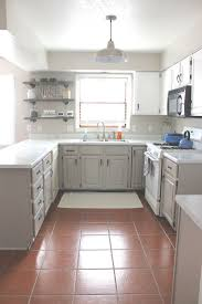 kitchen cabinets gray bottom white top our kitchen cabinets with nuvo cabinet paint the thome