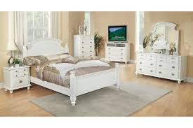 white varnished oak wood double bed frame with short poles and