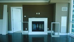 reliable built in cabinets beside fireplace wood ottoman modern
