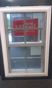 milgard tuscany double hung window with sculptured grids milgard