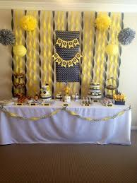 yellow and gray baby shower decorations dessert table at a chevron themed baby shower in yellow and gray